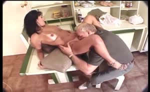 Busty Brunette Sucking On Some Old Guys Hard Cock